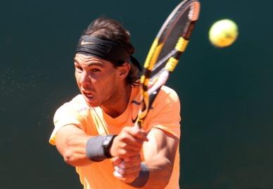 Spain's Rafael Nadal hits a return to Se